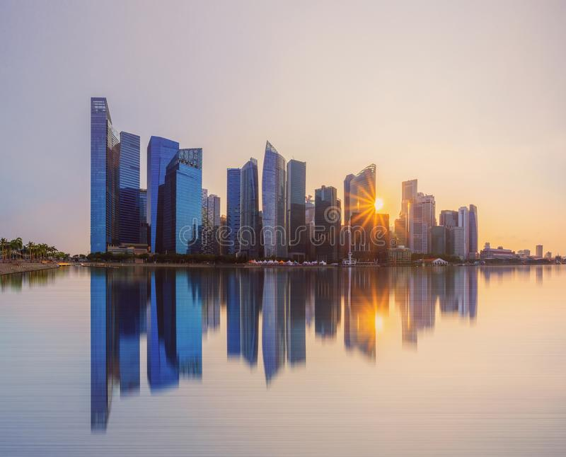 Singapore Downtown skyline at sunset with reflection. Financial district and business centers in technology smart urban city in. Asia. Skyscraper and high-rise royalty free stock photography