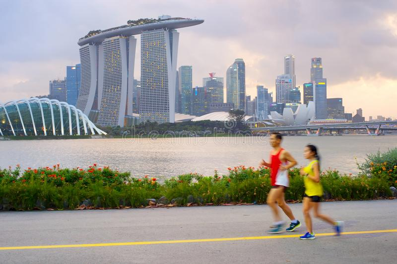 Couple running in Singapore royalty free stock photography