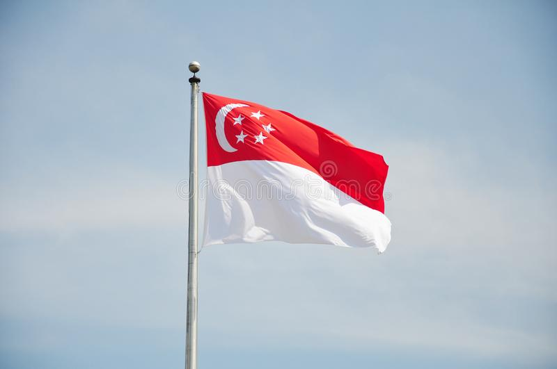 Singapore flag blowing in wind stock photos