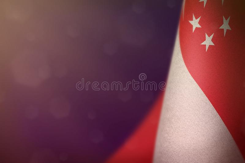 Singapore flag for honour of veterans day or memorial day. Glory to the Singapore heroes of war concept on purple dark velvet. Singapore hanging flag for honour royalty free illustration