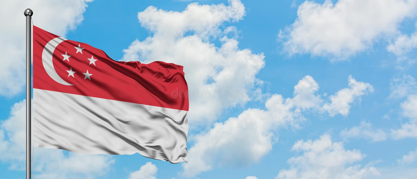 Singapore flag waving in the wind against white cloudy blue sky. Diplomacy concept, international relations.  royalty free stock images
