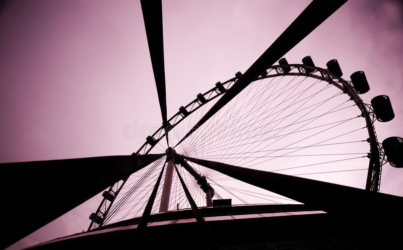 Singapore Flyer. Abstract wide angle of the Singapore Flyer with pink sky stock photos