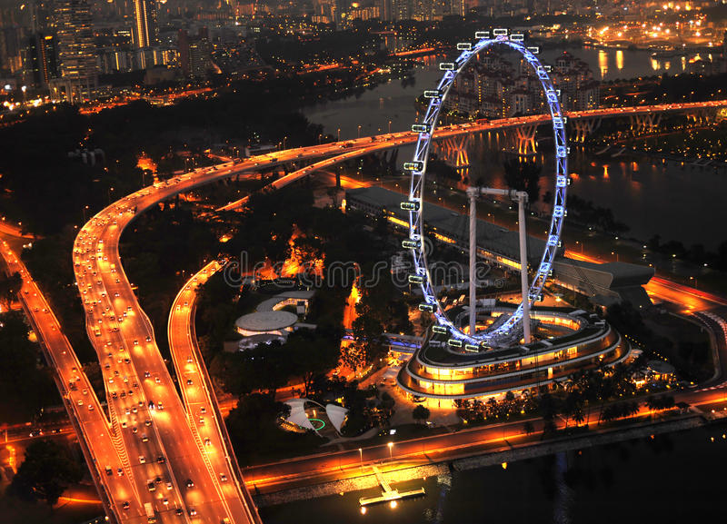 Singapore Flyer. Aerial view on Singapore Flyer from Marina Bay Sands resort at night royalty free stock photography