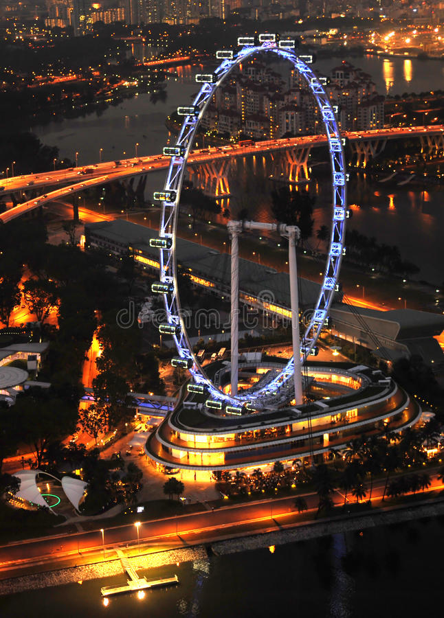 Singapore Flyer. Aerial view on Singapore Flyer from Marina Bay Sands resort at night royalty free stock photos