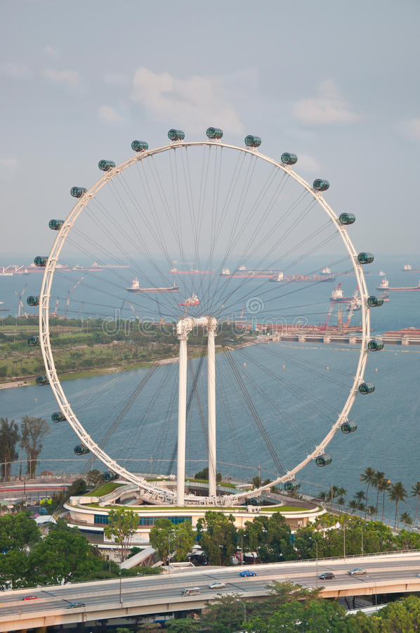 Singapore Flyer. Ferris wheel called Singapore Flyer located in the center of the city and being the highest wheel in Asia as of today with a total height of 165 stock photography