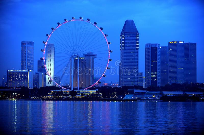 The Singapore Flyer. Is a giant Ferris wheel located in Singapore, constructed in 2005–2008. Described by its operators as an observation wheel, it stock photo