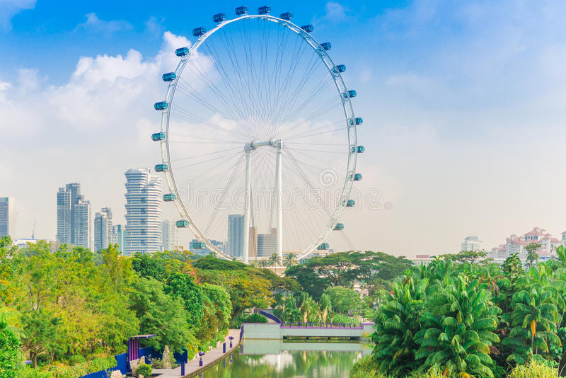Singapore Flyer against blue sky. The Largest Ferris Wheel in the World stock photos