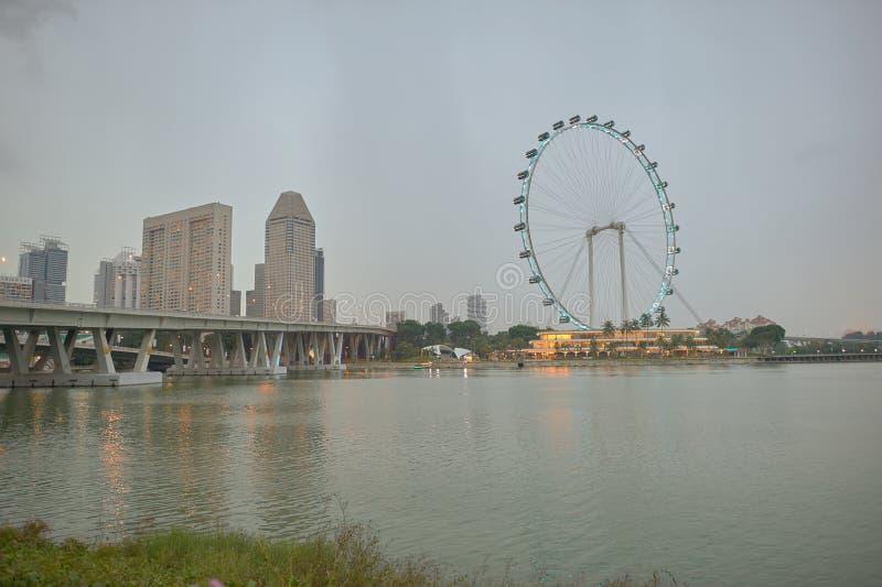 Singapore Flyer. SINGAPORE - CIRCA NOVEMBER, 2015: view of Singapore Flyer in the evening. The Singapore Flyer is a giant Ferris wheel stock photography