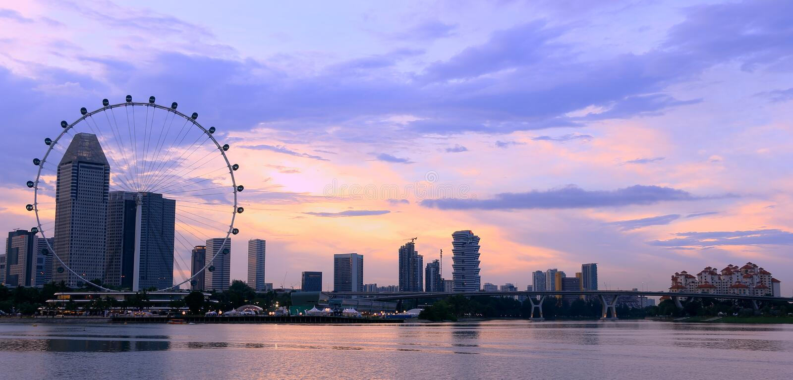 Singapore flyer and city in the sunset. Clouds in the sky royalty free stock photography