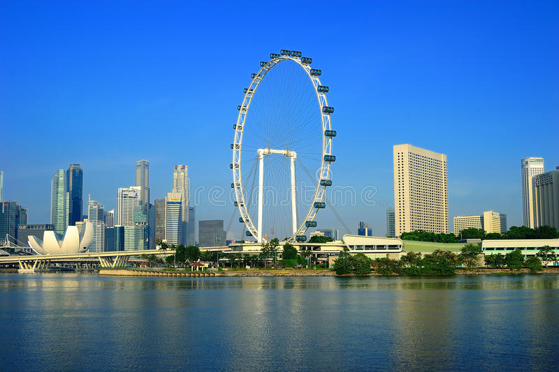 The Singapore Flyer and Cityscape. The Singapore Flyer is a giant Ferris wheel located in Singapore, constructed in 2005–2008. Described by its operators royalty free stock photo