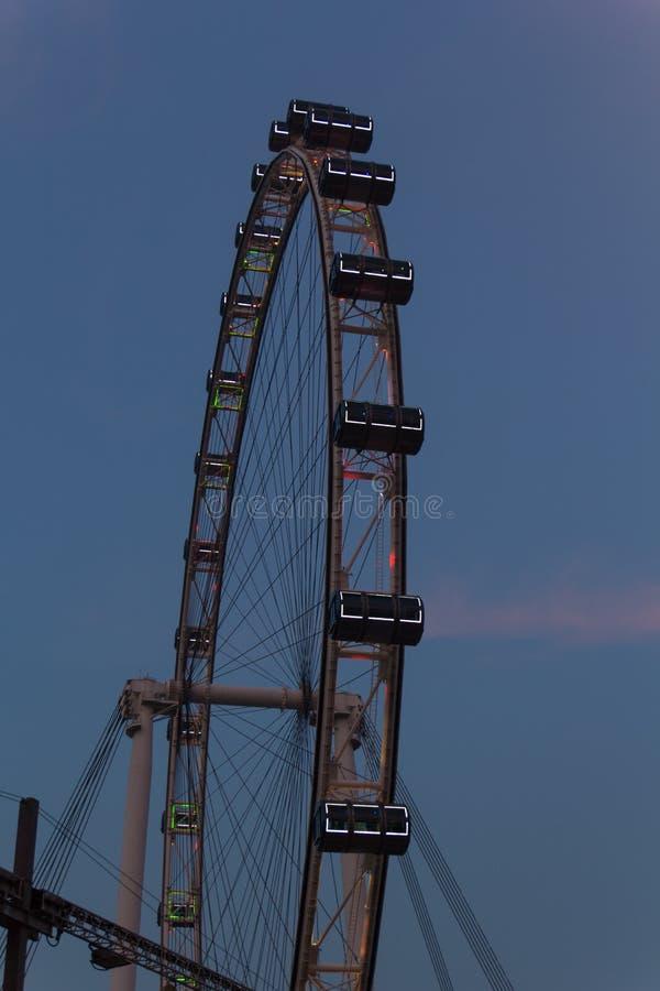Singapore Flyer. The ferris wheel Singapore Flyer at Sundown royalty free stock photography
