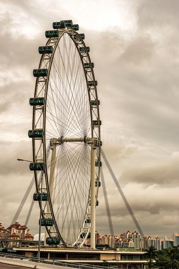 Singapore flyer at Marina Bay in Singapore. Singapore flyer it is huge 165meter public observation wheel opened in 2008 for views of the city and located at stock photography