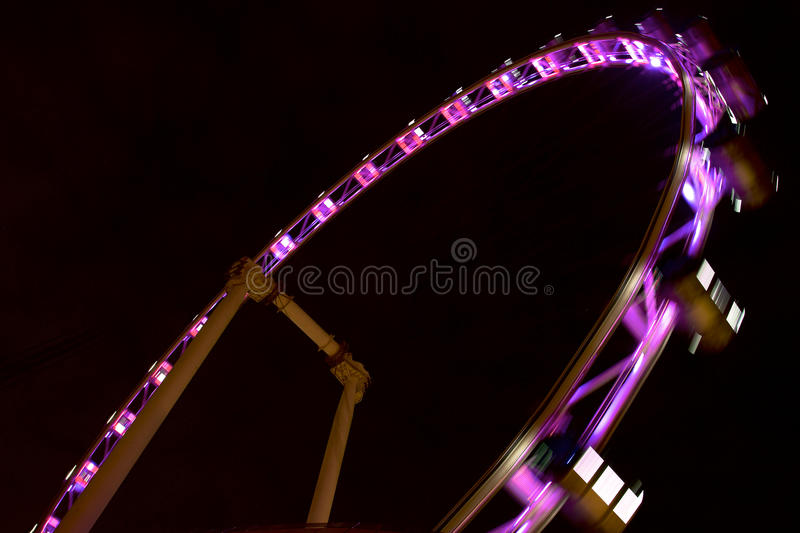Singapore flyer in motion. Popular Singapore flyer in motion from below at night stock photos