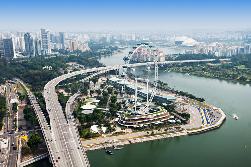Singapore Flyer. SINGAPORE - OCTOBER 18, 2014: Singapore Flyer, view from Marina Bay Sands Skypark stock image