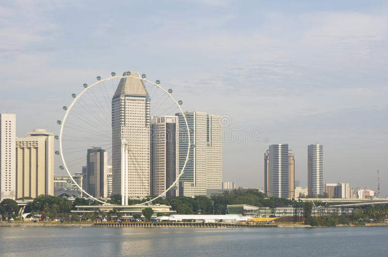 Singapore Flyer and skyline. Singapore Flyer and central business district, Singapore royalty free stock image