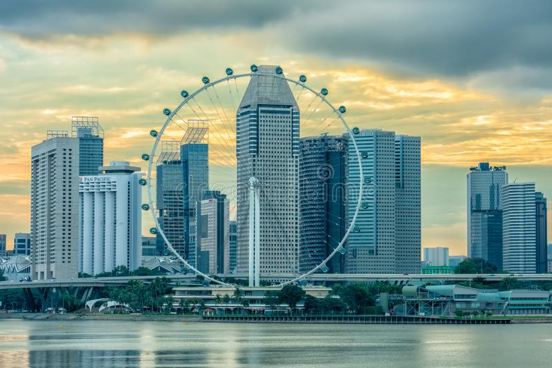 Singapore Flyer at sunset. Suntec City and Singapore Flyer at sunset royalty free stock photos