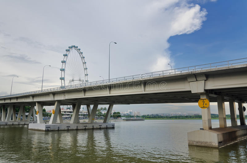 Singapore Flyer. View of Singapore Flyer from the bridge - the Largest Ferris Wheel in the World stock photos