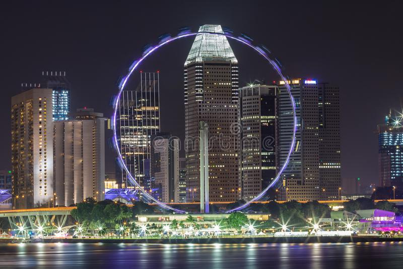 Singapore flyer at night and beautiful lighting. royalty free stock image