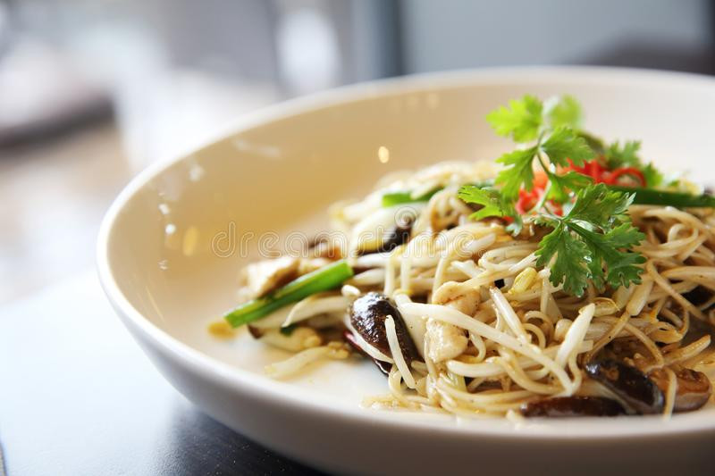Singapore fried noodle. On a plate stock photography