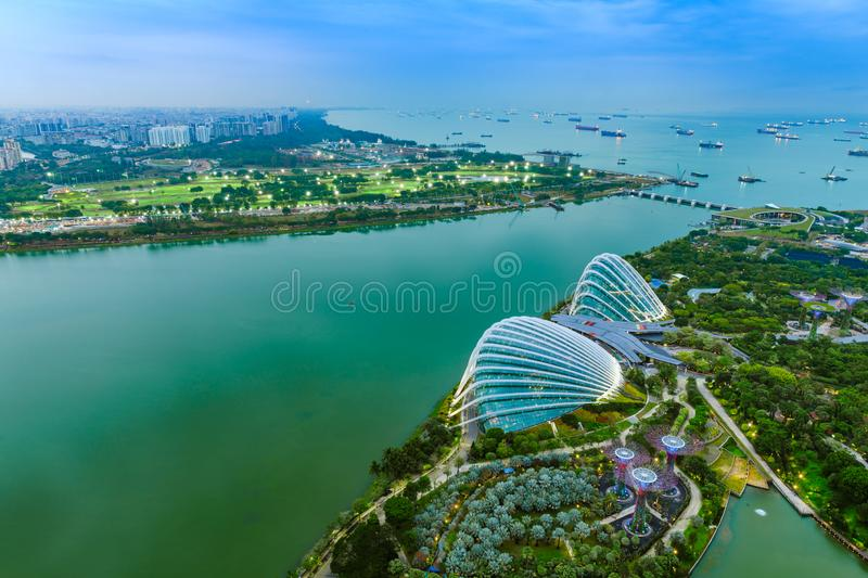 Singapore Gardens by the Bay botanical gardens aerial view and Marina Barrage dam with open sea stock photo