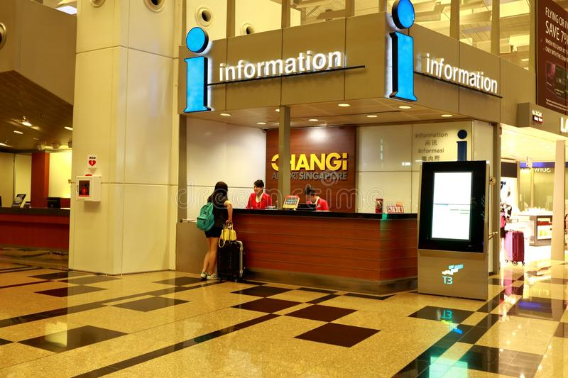 Singapore: Informatieteller bij Changi internationale Luchthaven T3 stock afbeelding