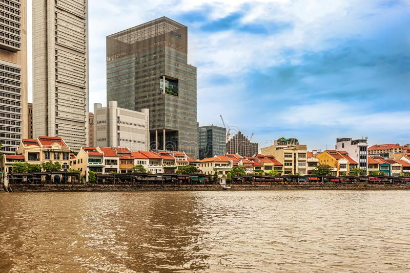 Colorful colonial houses along Singapore river in Singapore. Singapore - Jan 14, 2018: Colorful bars, restaurants and stores by the Singapore River along Clarke stock image