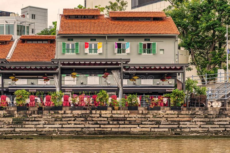 Colorful colonial houses along Singapore river in Singapore. Singapore - Jan 14, 2018: Colorful bars, restaurants and stores by the Singapore River along Clarke royalty free stock photo