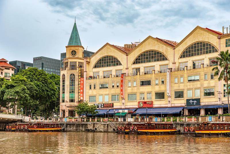 Colorful colonial houses along Singapore river in Singapore. Singapore - Jan 14, 2018: Colorful bars, restaurants and stores by the Singapore River along Clarke stock photos