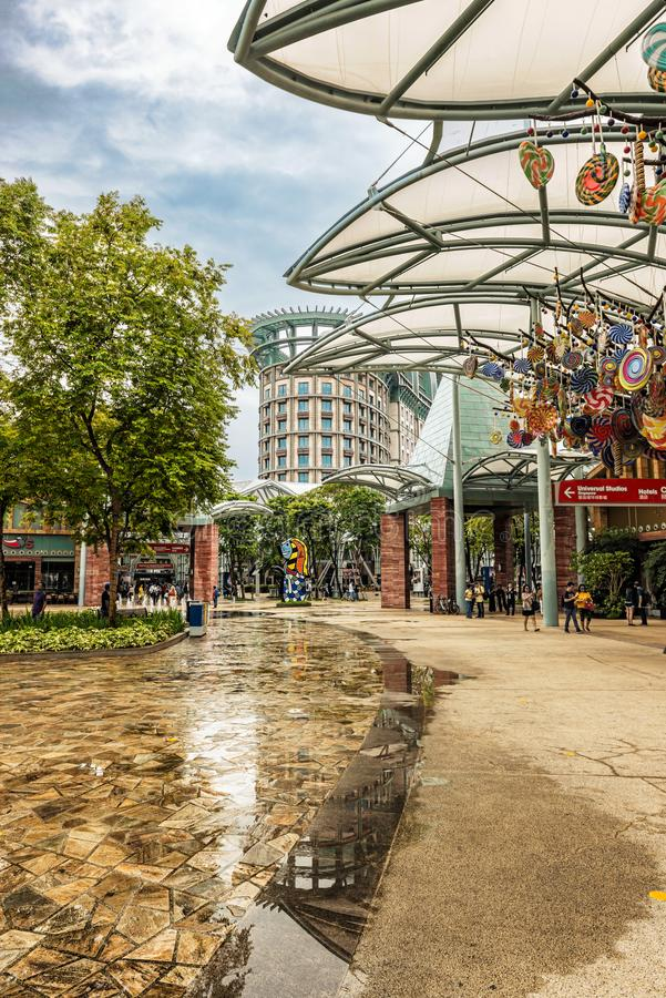 Commercial area on Sentosa island in Singapore. Singapore, - Jan 13, 2018: People visiting main commercial area with stores and restaurants on Sentosa island in stock photos