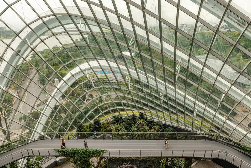 Cloud forest dome conservatory at Gardens by the Bay in Singapor. Singapore Jan 11, 2018: Tourists visiting cloud forest dome conservatory at Gardens by the Bay royalty free stock image