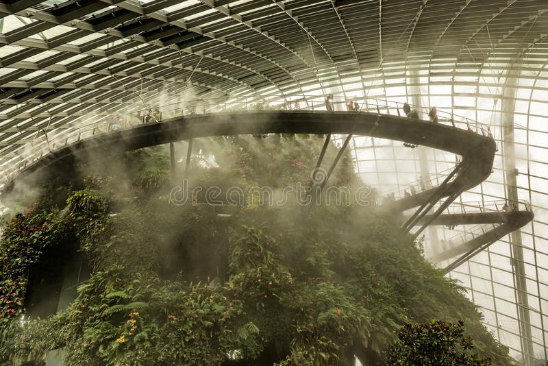 Cloud forest dome conservatory at Gardens by the Bay in Singapor. Singapore Jan 11, 2018: Tourists visiting cloud forest dome conservatory at Gardens by the Bay royalty free stock images