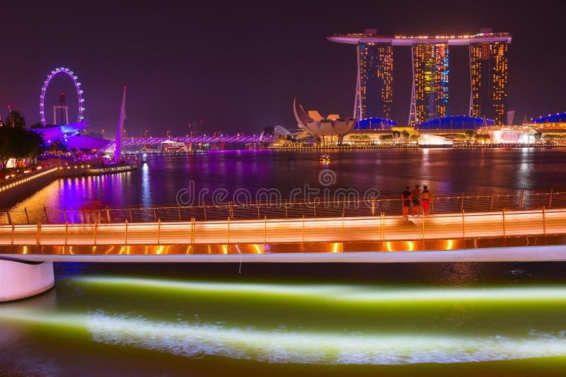 Marina Bay , Singapore Flyer night. SINGAPORE - JAN 14, 2017: View of Marina Bay Sands resort and Singapore Flyer at night in Singapore stock photography