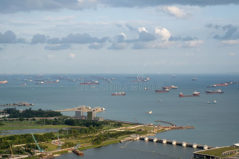 Anchorage area panorama opposite Gardens by the Bay with many ships on an anchorage. Singapore, January - 2019: anchorage area panorama opposite Gardens by the stock image