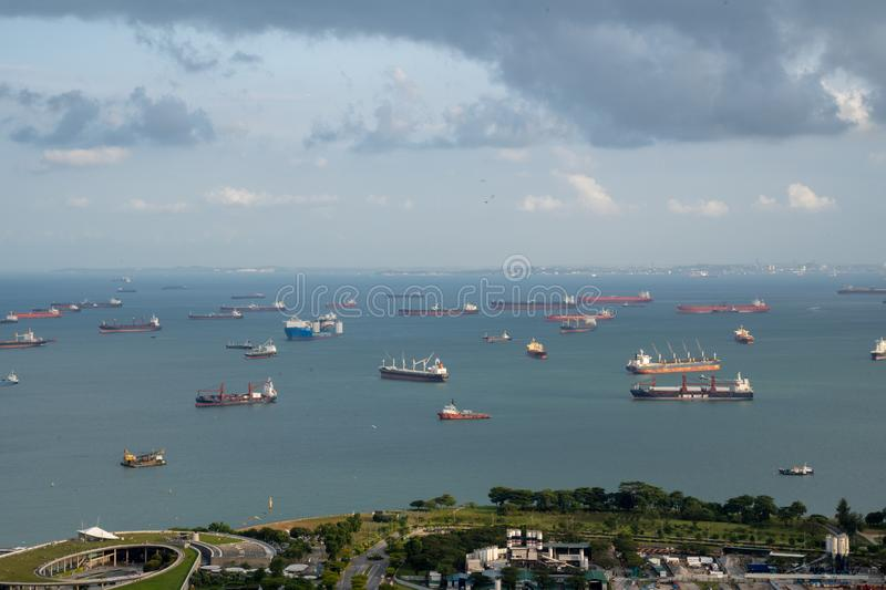 Anchorage area panorama opposite Gardens by the Bay with many ships on an anchorage. Singapore, January - 2019: anchorage area panorama opposite Gardens by the royalty free stock image