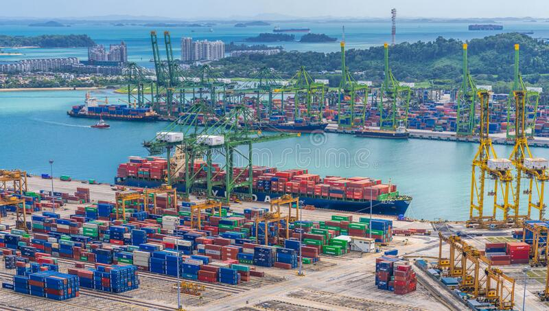 SINGAPORE-JANUARY 24,2020:Commercial port of Singapore. busiest Asian cargo port with hundreds of ships loading export and import royalty free stock image