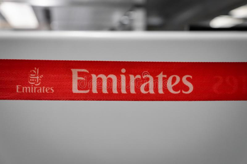 Emirates Airlines sign at check-in counter area in Singapore Changi Airport. stock photos