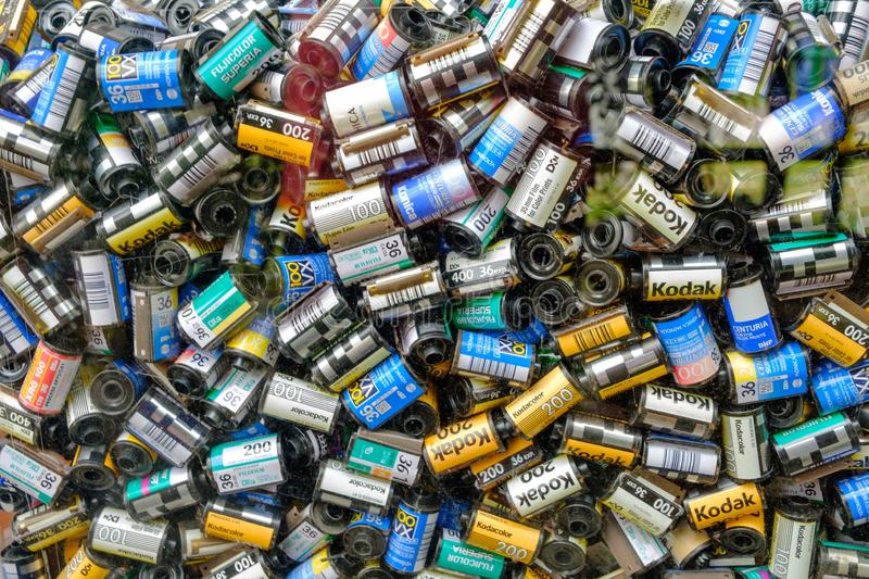 Many old film rolls that are put in the box royalty free stock photo