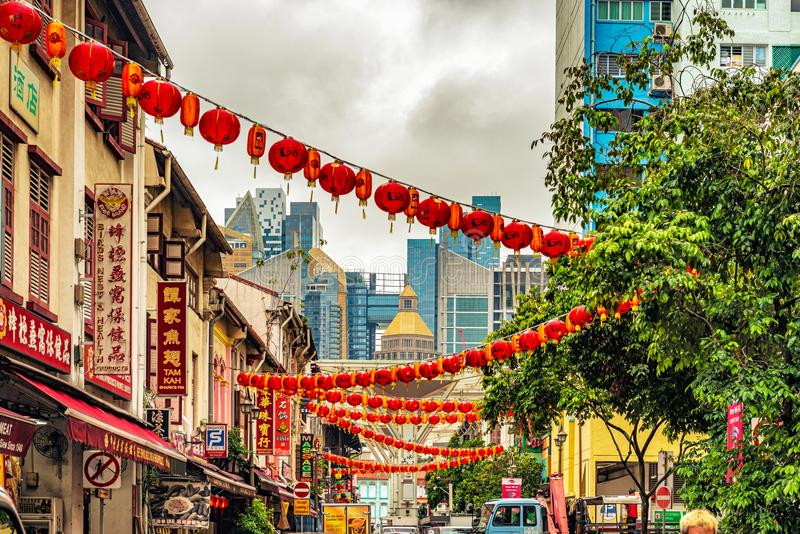 Colonial buildings in Chinatown, Singapore. Singapore - January 12, 2018: Signs at the street with the old colonial houses in the part of Singapore called royalty free stock image