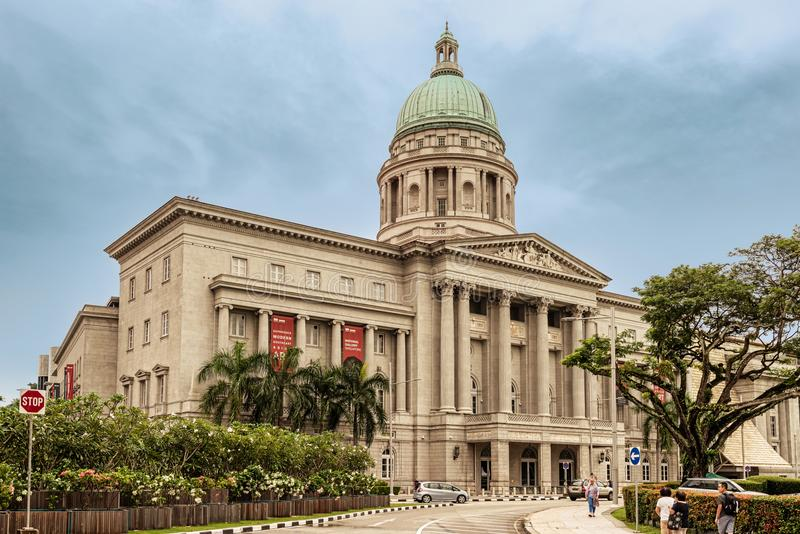 National Gallery building in Singapore. Singapore - January 14, 2018: Tourists walking in front of National Gallery in Singapore stock photo