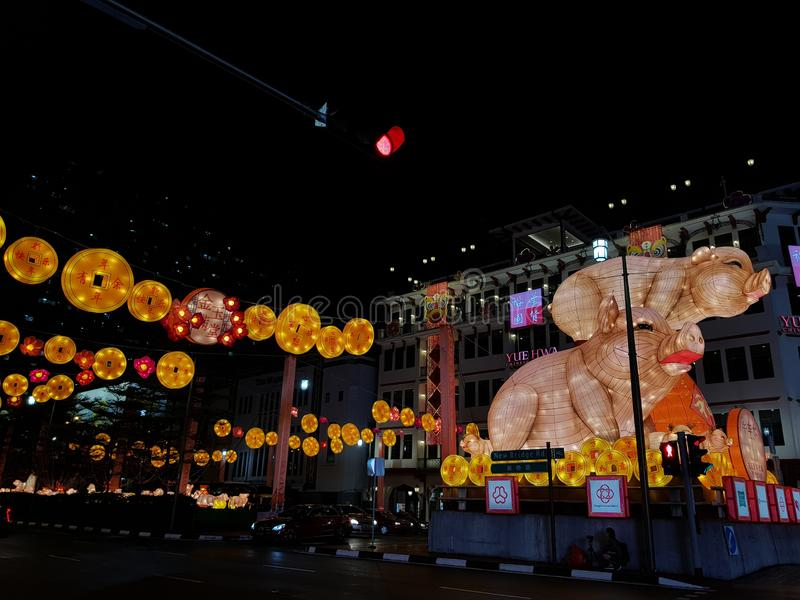 Traditional Chinese street lanterns decorations on a street of Singapore`s Chinatown for Chinese New stock photography