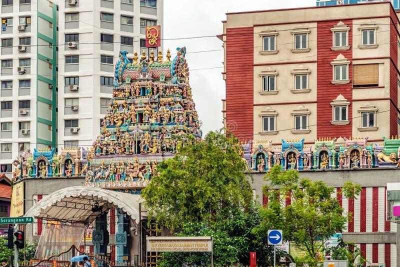 Sri Veeramakaliamman Hindu temple in Little India, Singapore. Singapore, January 12, 2018: Traffic on the street in front of Sri Veeramakaliamman Hindu temple royalty free stock photos