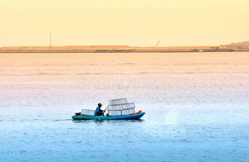 Singapore-29 JUN 2019:Fisherman is fishing in the sea by placing cages. Singapore-29 JUN 2019:Fisherman is fishing in the sea by placing fishing cages stock images