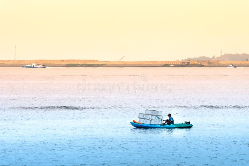 Singapore-29 JUN 2019:Fisherman is fishing in the sea by placing cages. Singapore-29 JUN 2019:Fisherman is fishing in the sea by placing fishing cages stock photo