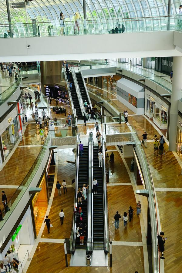Shopping mall with shoppers in Singapore royalty free stock photo