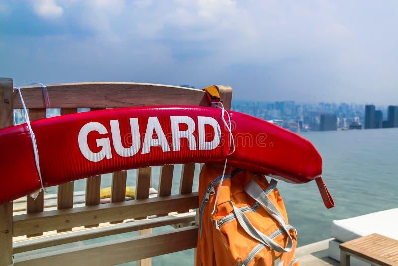 Singapore - 2011: Lifeguard post at pool of Marina Bay Sands. Singapore - 2011: Lifeguard post at rooftop pool of Marina Bay Sands Hotel royalty free stock photos