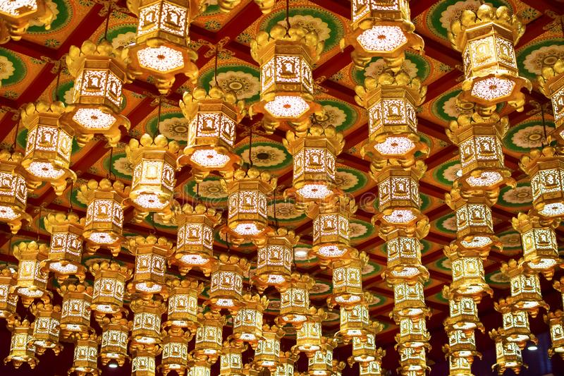 Singapore - March 4, 2018: Beautiful lights decoration on the ceiling in Buddha Tooth Relic Temple. Beautiful lights decoration on the ceiling in Buddha Tooth stock photos