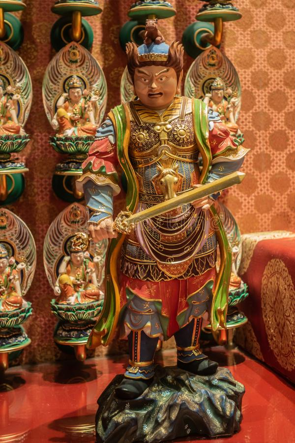Virudhaka statue in Buddha Tooth Relic Temple, Singapore stock images
