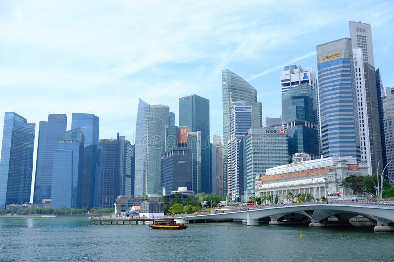 Singapore - March 7, 2019 : Singapore Business District. Fullerton hotel building at Marina Bay in Singapore and ferry boat at Jub stock images