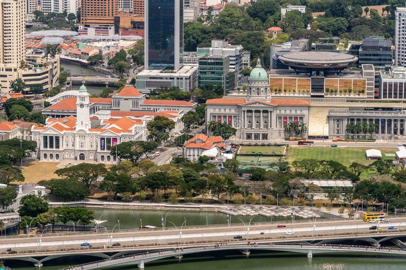 Birds eye on Victoria Theatre and National Gallery in Singapore. Singapore - March 21, 2019: Shot from Sands roof. Birds eye view on white Victoria Theatre with stock images