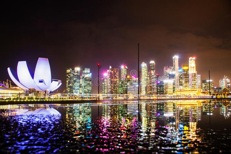 SINGAPORE, SINGAPORE - MARCH 2019: skyline of Singapore Marina Bay at night downtown core skyscrapers and the Art Science museum stock photo